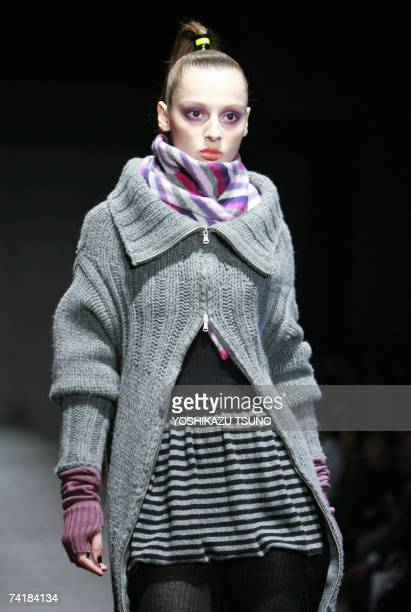 A model displays zipped woolen long cardigan at the Italian casual brand Benetton's fall and winter collection in Tokyo 18 May 2007 AFP PHOTO /...