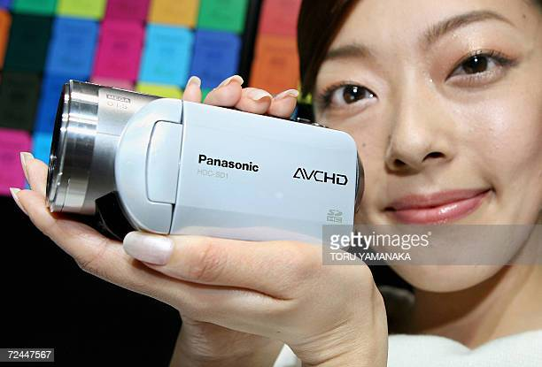A model of Matsushita Electric Industrial known by its Panasonic brand shows off the new 3CCD highdefinition digital camcorder HDCSD1 at the...