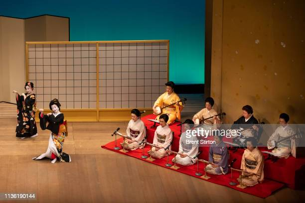 A Oneisan practices with her Shamisen at the Asakusa Kenban where Geisha shows are held for clients The bridge of the Shamisen is made of ivory and...