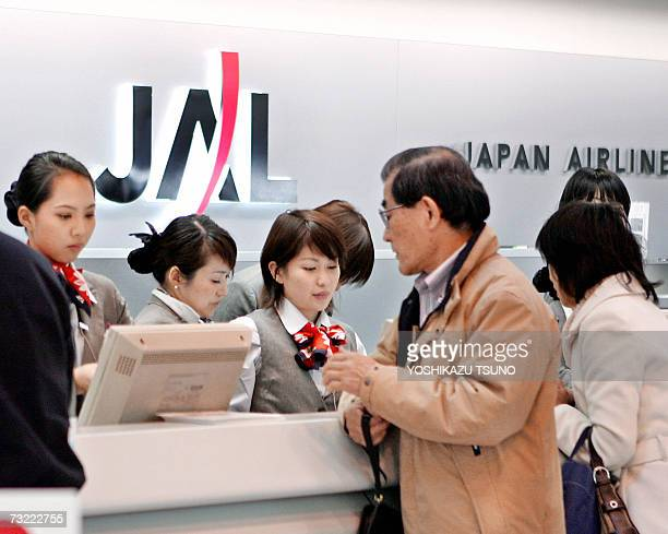 Asia's largest air carrier Japan Airlines ground staffs give tickets to customers at a counter of Tokyo's Haneda Airport 06 February 2007 JAL said it...