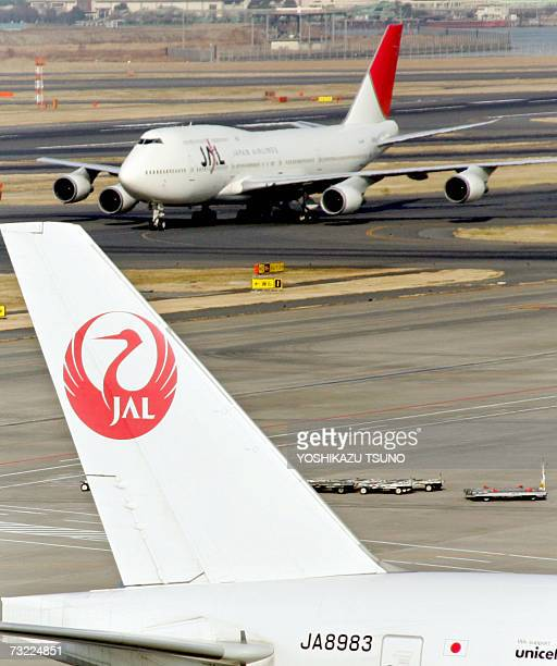 Asia's largest air carrier Japan Airlines jet liners park on the apron of Tokyo's Haneda Airport 06 February 2007 JAL said it suffered another third...