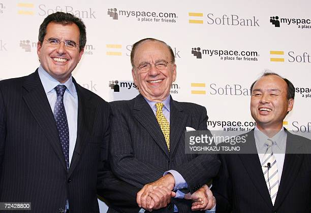Australian media baron Rupert Murdoch Chairman and CEO of News Corporation along with the President of News Corporation Peter Chernin shakes hands...