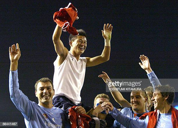 Australia's Sydney FC forward Kazu Miura from Japan is carried by his teammates after the team beat Egyptian football club team Al Ahly in their 5th...