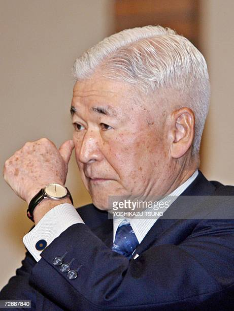 Bank of Japan Governor Toshihiko Fukui listens to the speech delivered by his French counterpart Christian Noyer at a business forum to encourage...