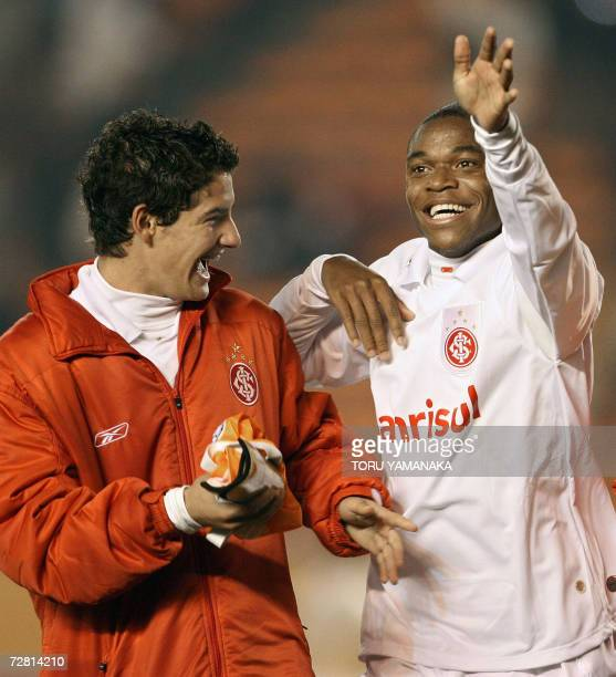 Brazilian SC Internacional forward Luiz Adriano celebrates with teammate Alexandre Pato after their win against Egyptian football club Al Ahly in the...