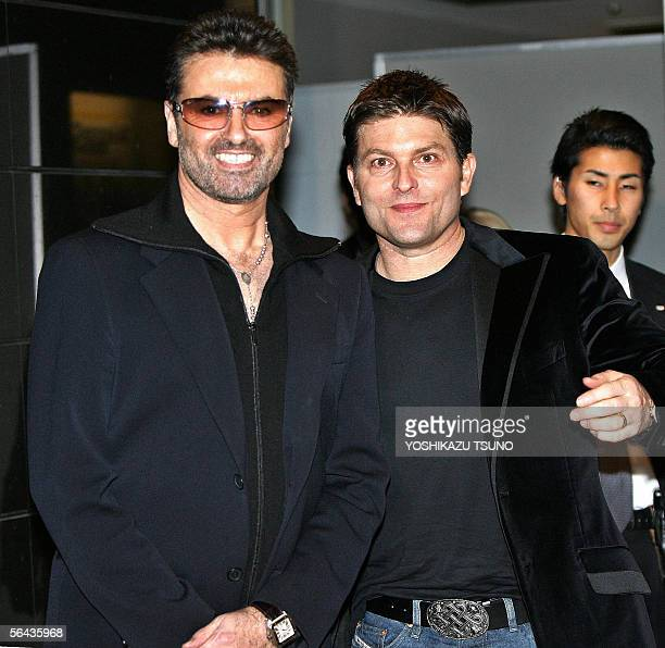 British pop star George Michael smiles with his partner Kenny Goss at a reception after the Japan premiere of his autobiographical movie George...