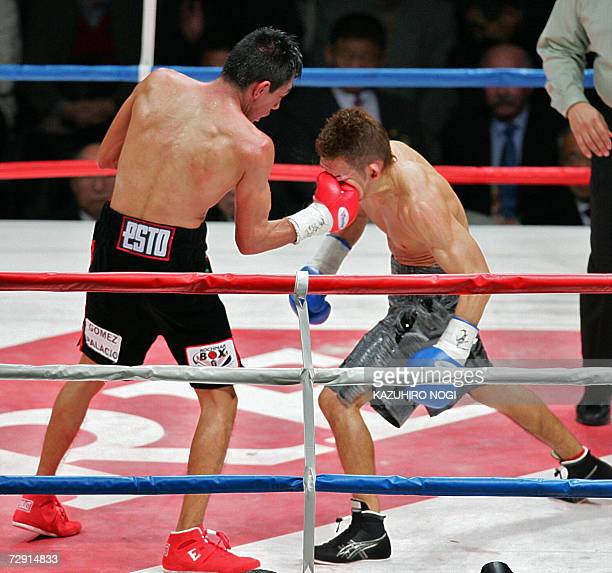 Champion Cristian Mijares of Mexico hits a right uppercut to Japanese challenger Katsushige Kawashima in the 9th round of their WBC super flyweight...