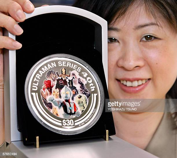 Chikako Kubo of Japanse money commodity trader Taisei displays a ounce Tsubaruan gold coin and onekilogram silver coin designed after the popular...