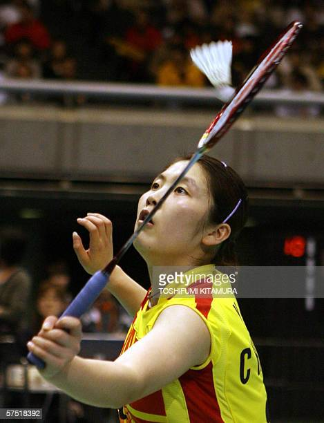Chinese badminton player Jiang Yanjiao returns a shuttle during the quarter-final round of the Uber Cup badminton tournament against Xiang Aiying of...