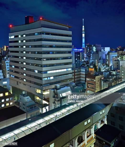 """tokyo, japan - city view at night of asakusabashi and asakusa districts, with the iconic """"tokyo skytree"""" tower in the distance - carlos alkmin stock pictures, royalty-free photos & images"""