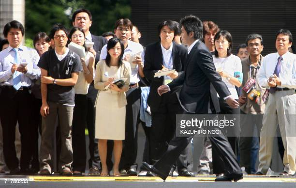 CORRECTION CITY IN FIELD Takafumi Horie the flamboyant founder of Japan's once highflying Livedoor Internet firm walks past news reporters upon his...