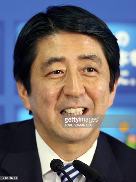 CORRECTION FINANCE MINISTER'S NAME Chief Cabinet Secretary Shinzo Abe smiles as he answers questions from reporters during a joint press conference...