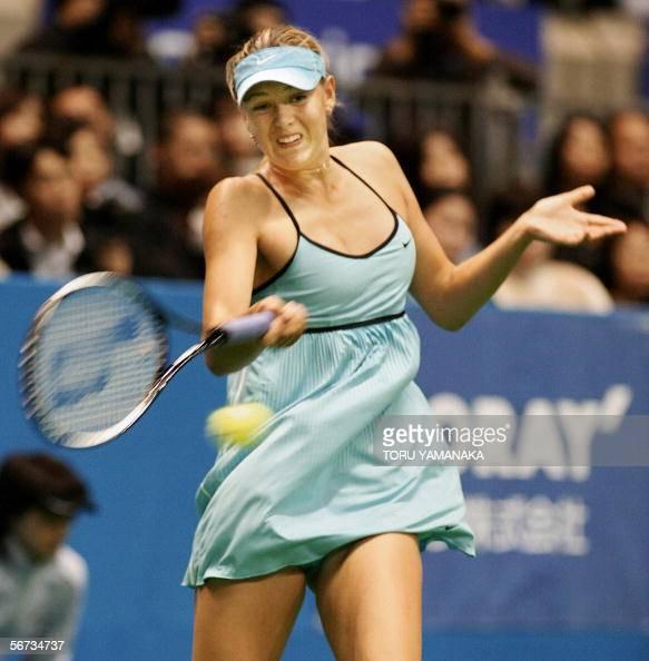 Defending champion Maria Sharapova of Russia returns the ...