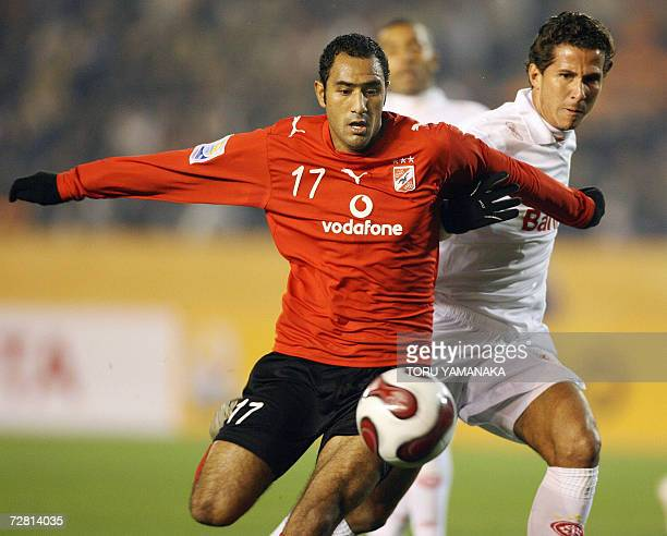 Egyptian football club Al Ahly midfielder Mohamed Shawky battles for the ball with Brazilian SC Internacional defender Fabiano Eller during the first...