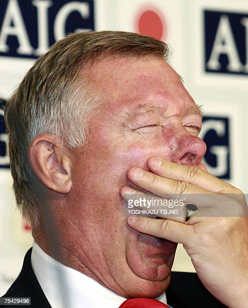 England's Manchester United head coach Alex Ferguson yawns during a press conference upon the teams arrival at a Tokyo hotel after a long flight 16...