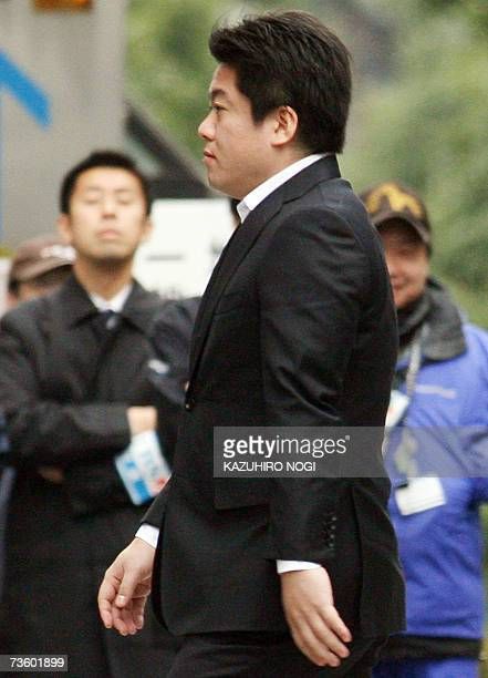 Former Livedoor Co President Takafumi Horie arrives at Tokyo District Court 16 March 2007 The court sentenced disgraced Internet tycoon Horie to two...