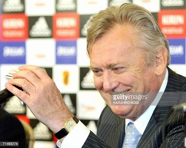 Former Yugoslav coach Ivica Osim smiles as he attends a news conference after a signing sesion on a contract to become Japan's new national coach at...
