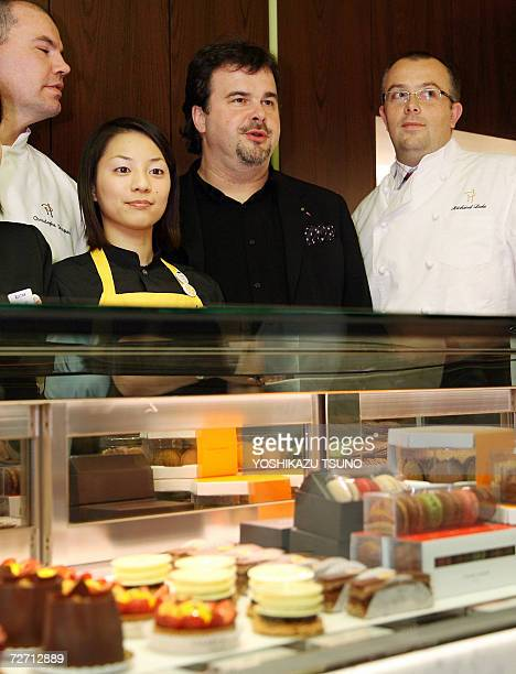 French chef Pierre Herme smiles with members of his Japanese and French staff as he opens his shop at the Isetan department store in Tokyo, 04...