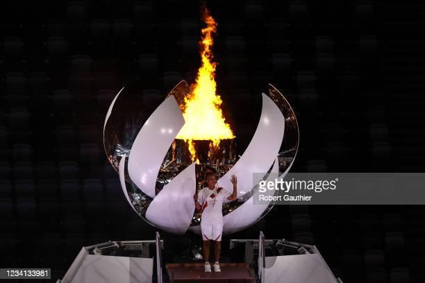 Tokyo, Japan, Friday, July 23, 2021 - Naomi Osaka lights the Olympic flame at the Tokyo 2020 Olympics Opening Ceremony at Olympic Stadium.
