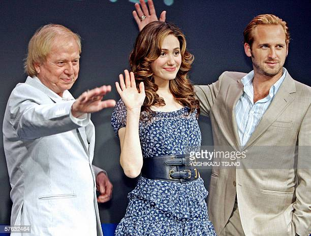 German film director Wolfgang Petersen and actors Emmy Rossum and Josh Lucas waves to photographers at a press conference for the promotion of their...