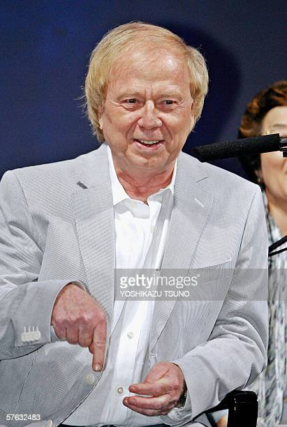 "German film director Wolfgang Petersen gestures as he speaks during a press conference for the promotion of his movie ""Poseidon"" at a Tokyo hotel, 17..."