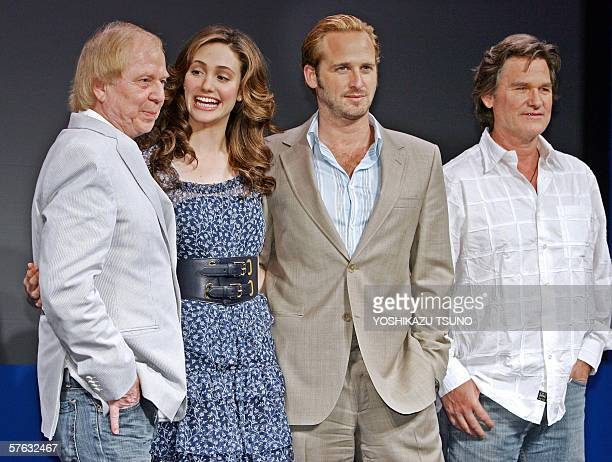 German film director Wolfgang Petersen smiles with actors Kurt Russel , Josh Lucas and Emmy Rossum at a press conference for the promotion of their...