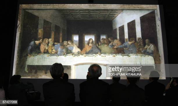 Guests look at a lifesized projected image of The Last Supper which is 46m x 88m during a press preview of the digital exhibition The Da Vinci Code...
