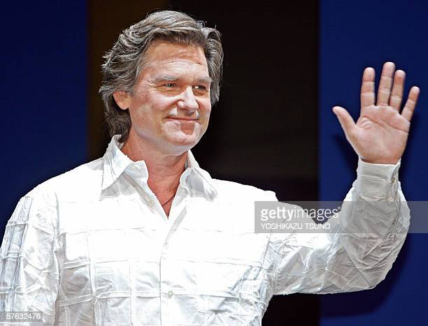 "Hollywood actor Kurt Russel waves during a press conference for the promotion of the movie ""Poseidon"" at a Tokyo hotel, 17 May 2006. The movie will..."