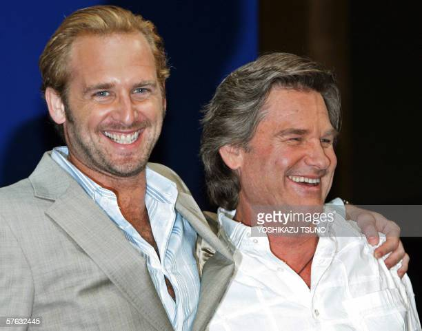 "Hollywood actors Kurt Russel and Josh Lucas smile during a press conference for the promotion of their movie ""Poseidon"" at a Tokyo hotel, 17 May..."