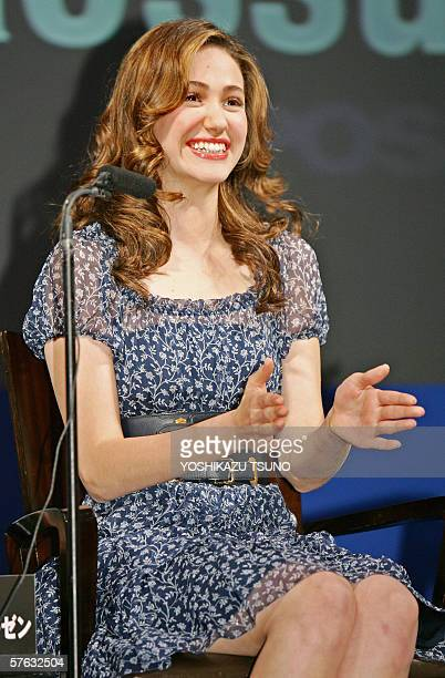 "Hollywood actress Emmy Rossum gestures as she speaks during a press conference for the promotion of his movie ""Poseidon"" at a Tokyo hotel, 17 May..."