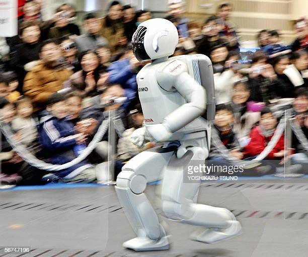 Japanese auto giant Honda Motor's humanoid robot Asimo which can run at a speed of 6 kph and also in a circular pattern shows his skill before...