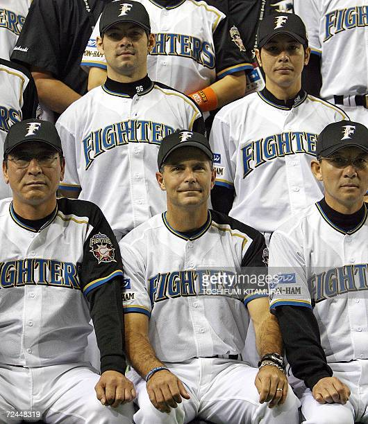 Japanese baseball team Nippon Ham Fighters head coach Trey Hillman from the US poses in a team photo session including coaches Kazuyuki Shirai and...