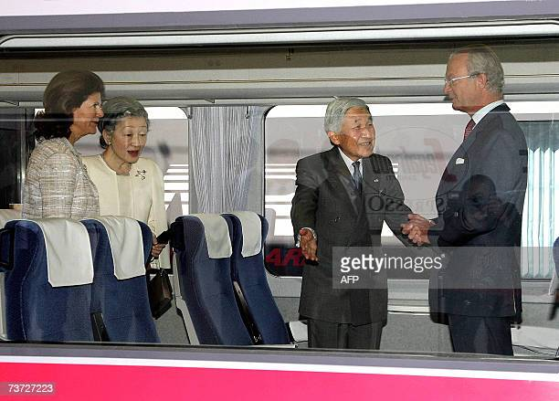 Japanese Emperor Akihito offers a seat to Swedish King Carl XVI Gustaf on the train accompanied by Japanese Empress Michiko and Swedish Queen Silvia...