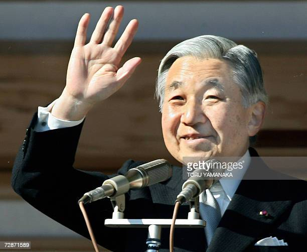 Japanese Emperor Akihito waves from a balcony to people as he celebrates his 73rd birthday at the Imperial Palace in Tokyo 23 December 2006 Around...