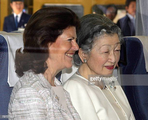 Japanese Empress Michiko and Swedish Queen Silvia smile on the train at Seibu Railway Shinjuku Station in Tokyo 28 March 2007 as they leave with...