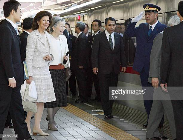 Japanese Empress Michiko and Swedish Queen Silvia walk along the platform at Seibu Railway Shinjuku Station in Tokyo 28 March 2007 as they leave with...