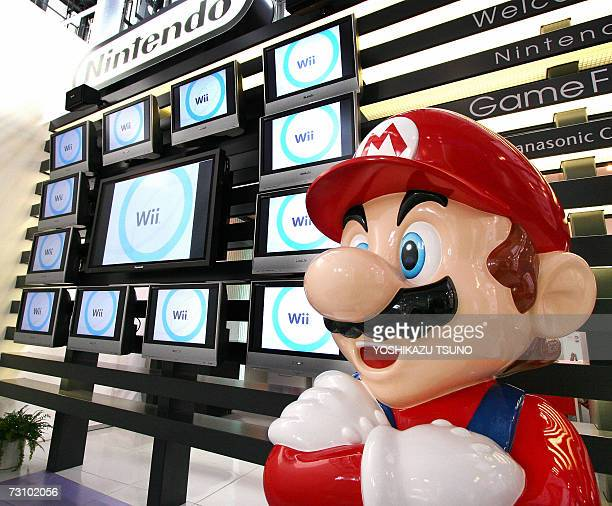 Japanese video game giant Nintendo's game character Super Mario stands at a showroom in Tokyo 25 January 2007 Nintendo said that its net profit rose...