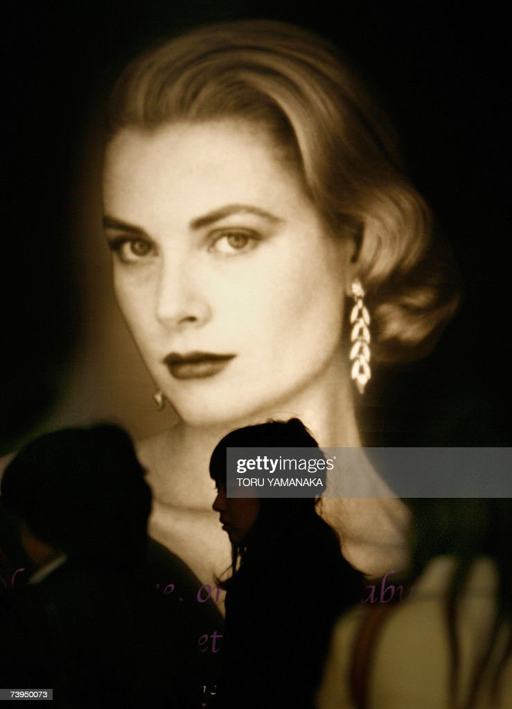 Japanese women walk past a portrait of Princess Grace at the entrance of the 'La Princesse Grace de Monaco' exhibition in a Tokyo department store, 23 April 2007. Prince Albert II of Monaco also visited the two-week exhibition today during his three-day stay in Japan. AFP PHOTO/Toru YAMANAKA