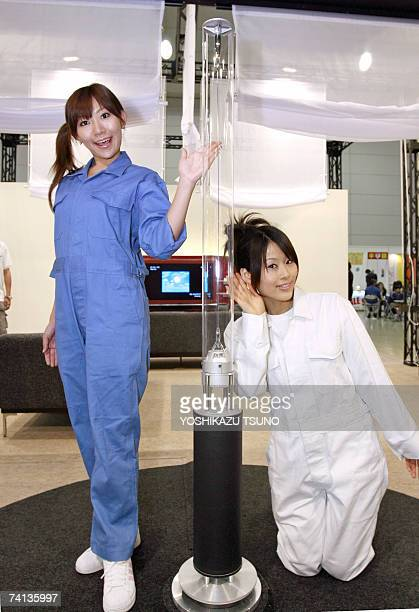 """Japan's electronics giant Sony employees display the prototype model of transparent pole speaker system """"Rin"""", which renders stereo sound towards all..."""