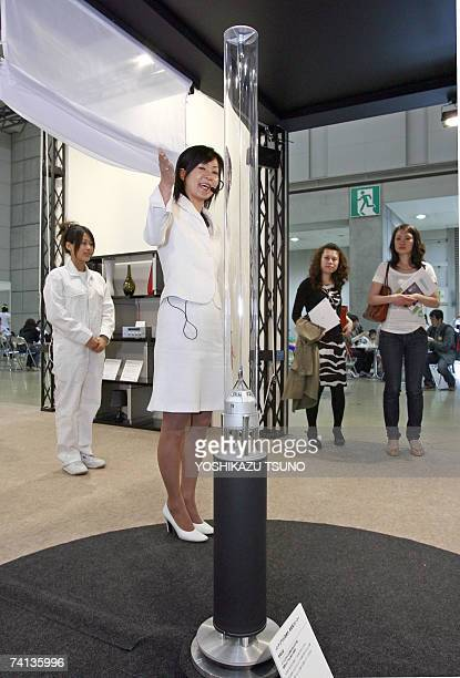 "Japan's electronics giant Sony employees introduce the prototype model of transparent pole speaker system ""Rin"", which renders stereo sound towards..."