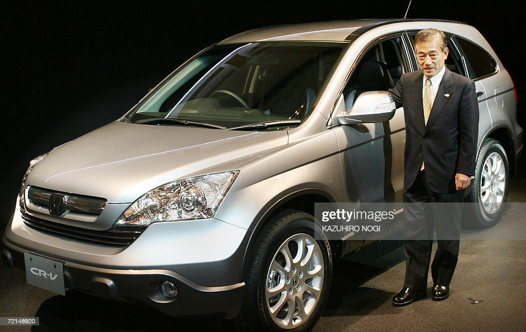 Japans honda motor co ltd president t pictures getty images japans honda motor co ltd president takeo fukui stands next to the all sciox Image collections