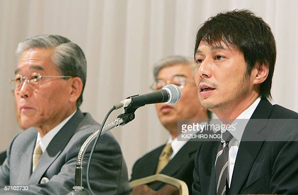 Japan's Internet service provider Usen President Yasuhide Uno speaks at a news conference in Tokyo 16 March 2006 while Fuji Television Network...