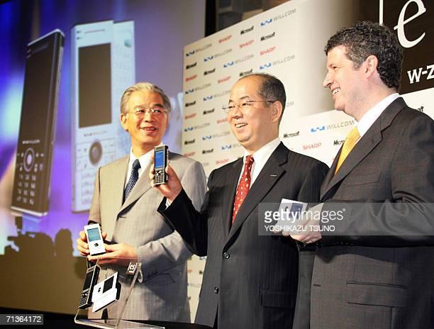 Japan's mobile communication operator Willcom President Yoichiro Yatsurugi Japanese electronics giant Sharp Vice President Masafumi Matsumoto and...