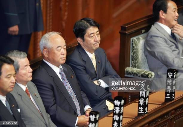 Japan's new Prime Minister Shinzo Abe and his cabinet members attends a plenary session of the House of Representatives at the Diet in Tokyo 28...