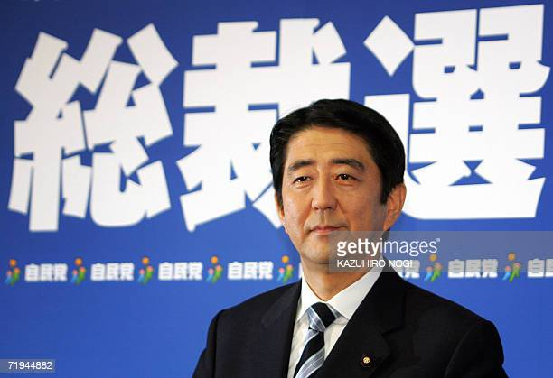 Japan's Shinzo Abe the newly elected as the president of the ruling Liberal Democratic Party poses for the press prior to his news conference at LDP...