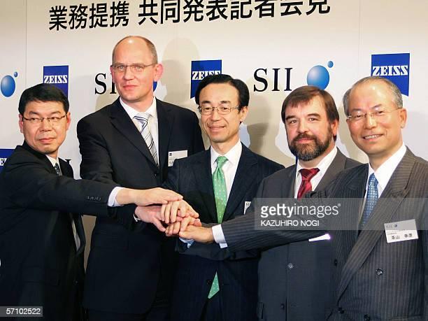 Japan's SII Nano Technology Inc president Hiroyuki Funamoto Carl Zeiss NTS managing director Dirk Stenkamp Seiko Instruments Inc chairman Junichi...
