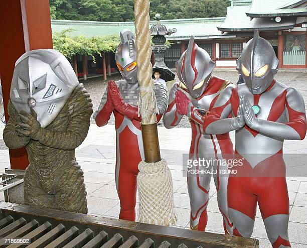 Japan's TV and movie heros Ultraman, Ultraman-mebius, Ultra-seven and a monster pray for a big hit of Ultraman's new movie at Tokyo's Hie shrine, 13...