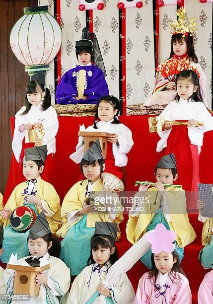Kindergarten children in traditional costumes and tiaras pose on a platform for hinamatsuri or doll festival at Tokyo's Mukojima Bunka kindargarten...