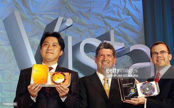 Microsoft corporation corporate vice president and Japan's Microsoft KK president Darren Huston Microsoft KK's director Nobuyoshi Yokoi and Microsoft...