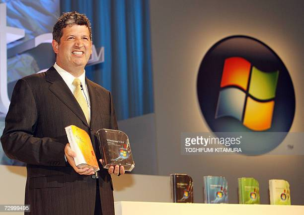 Microsoft corporation corporate vice president and Japan's Microsoft KK president Darren Huston shows off packages of the company's new operation...